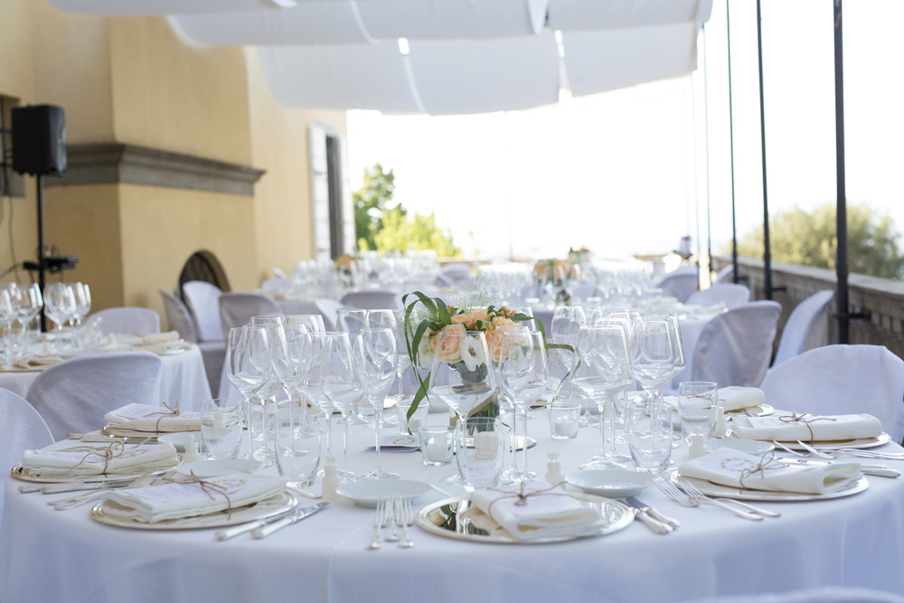 setting up the location for a wedding lunch in an ancient Tuscan villa